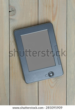 E-book on a wooden background - stock photo