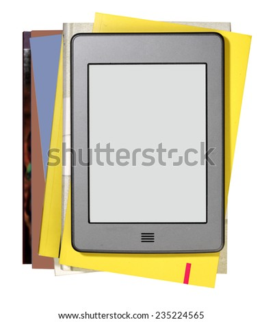 E-book reader on books. - stock photo