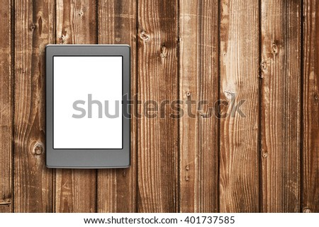 E-book reader on wooden table top view - stock photo