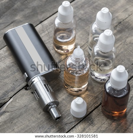 e-cigarettes with different re-fill bottles,from above - stock photo