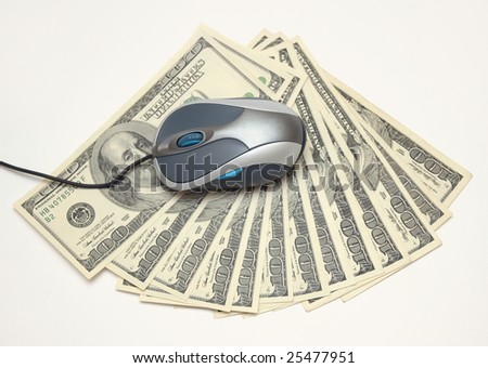 E-commerce - computer mouse and dollars - stock photo