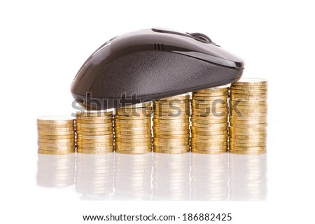 E-commerce. Computer mouse and gold coins. - stock photo