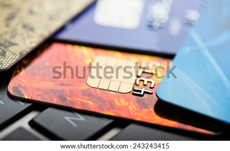 E-commerce concept. group of credit cards and laptop with shallow DOF  - stock photo