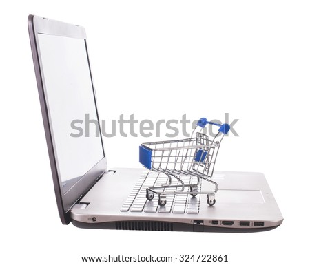 E-commerce. Shopping cart with cardboard boxes on laptop. The concept of online shopping store. - Stock image - stock photo
