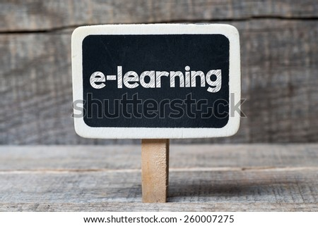 E-learning on framed blackboard. E-learning handwritten on framed blackboard - stock photo