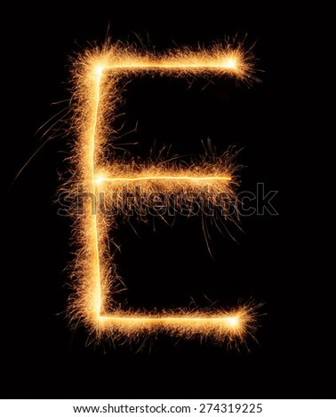 E letter drawn with bengali sparkles isolated on black background - stock photo