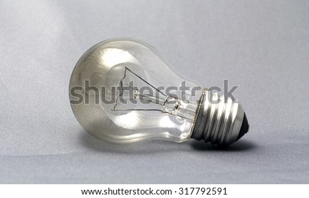 E27 Light bulb isolated on a grey background - stock photo