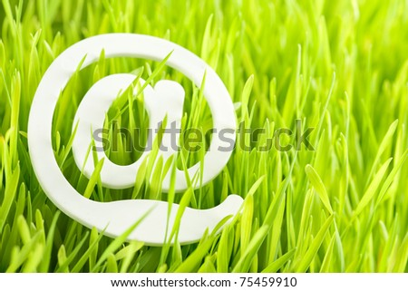 e-mail and fresh grass - stock photo