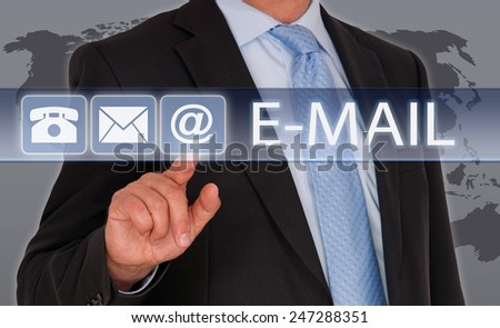 E-Mail - Businessman with touchscreen and world map in the background - stock photo
