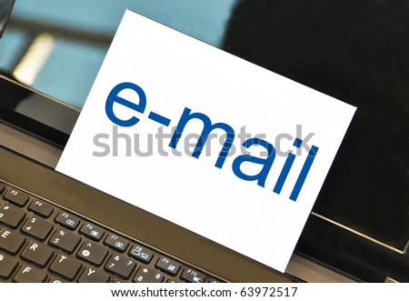 E-MAIL envelop on the notebook - stock photo