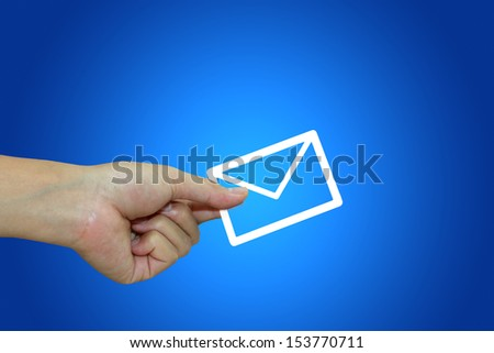 e-mail in the hand on blue background. - stock photo