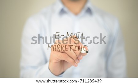 E-Mail Marketing,  Man writing on transparent screen