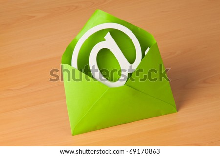 E-mail sign is in a green envelope. - stock photo