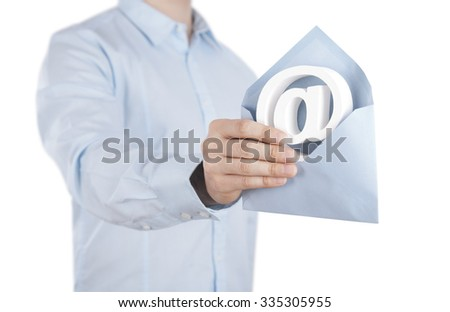 E-mail symbol with envelope in hand. Clipping path included.  - stock photo