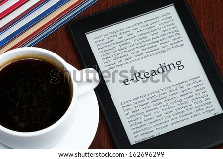 e-Reader and coffee on a table - stock photo