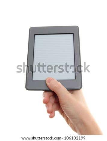 E-reader and hand. The reader is deprived of all brand names and buttons. - stock photo