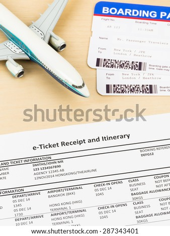 E-ticket with plane model, and boarding pass; e-ticket and boarding pass are mock-up - stock photo