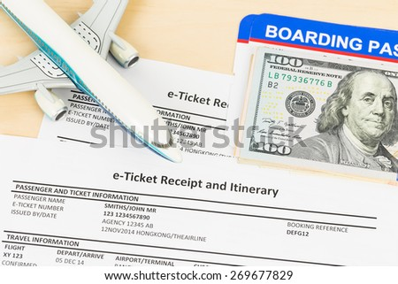 E-ticket with plane model, banknote, and boarding pass; these documents are mock-up