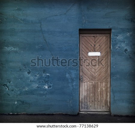 e vintage door with empty white doorplate - stock photo