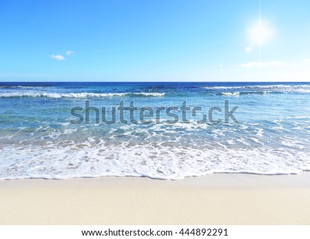 each scene, white sand and clear blue sky with sunbeam