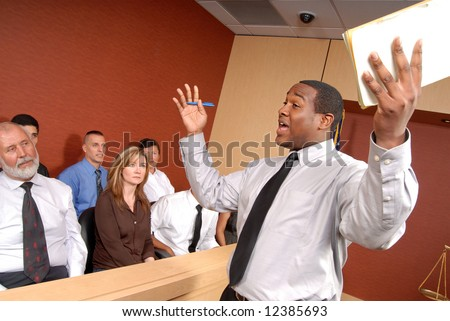 Eager and passionate attorney trying to convince the jury of his point - stock photo