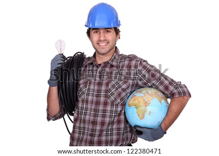 Eager electrician installing electrical systems abroad - stock photo