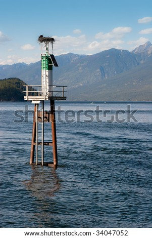 Eagle's nest on lighthouse in middle of lake - stock photo