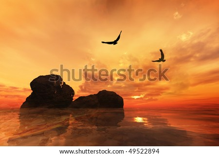 Eagles flying over rocks with a beautiful sunset - stock photo