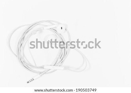 Ear buds on a white background - stock photo