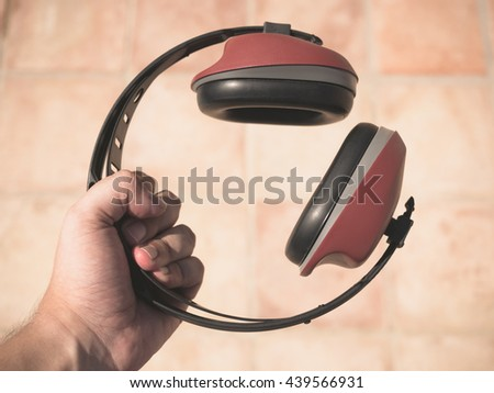 ear muff to protect workers' ears - stock photo
