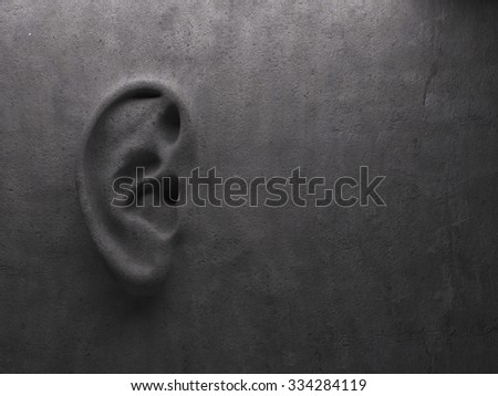 Ear on wall concept  - stock photo