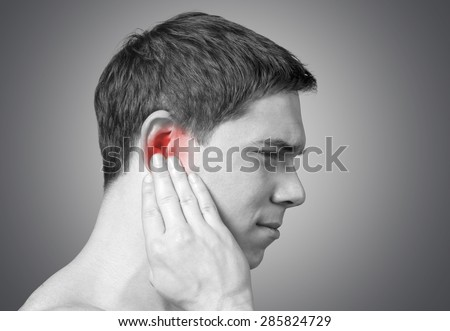 Ear, pain, pressure. - stock photo