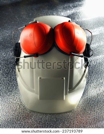 Ear Protectors and Hard Hat - stock photo