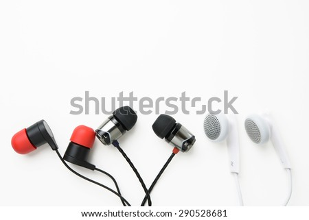 earbuds on white background - stock photo