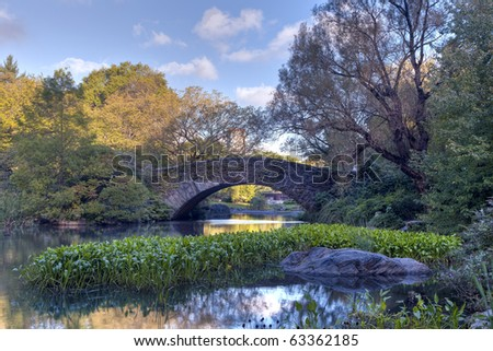 Early autumn in Central Park by the lake - stock photo