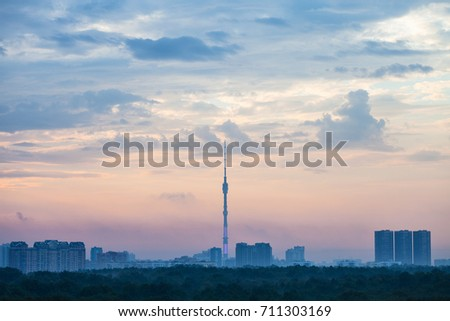 early blue and pink sunrise over Moscow city with Ostankino TV Tower and Timiryazevskiy park in summer morning