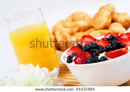 Early breakfast. Strawberries, cream and juice. The symbol of healthy lifestyles. - stock photo