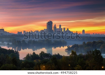 Early colorful morning in Moscow. Winding Moskva river and big residential district afar.