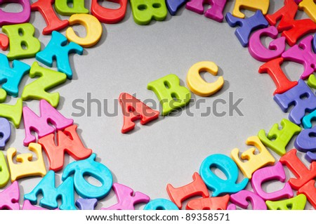 Early education concept with letters - stock photo