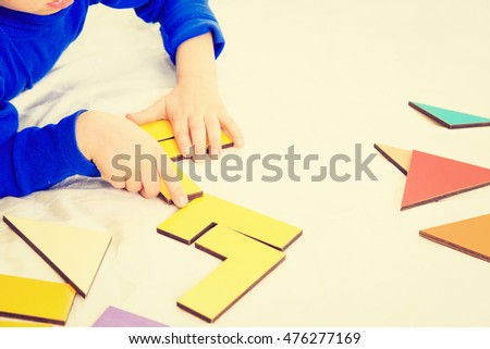 early education -little boy playing with puzzle