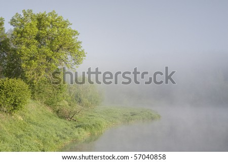 Early foggy morning at the Neris river, Lithuania - stock photo