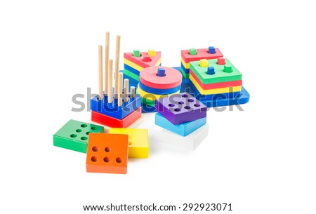 Early learning Montessori toys:  multicolored logical and geometric pyramids for geeks isolated on white background - stock photo