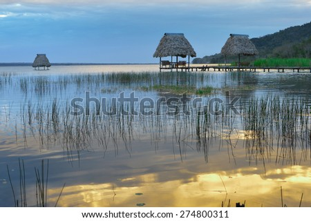 Early minutes of sunset at the lake Peten Itza in El Ramate village, Guatemala - stock photo