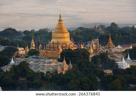 Early morning aerial view of the Shwezigon Pagoda near the Irrawaddy River in Bagan in Myanmar (Burma). - stock photo