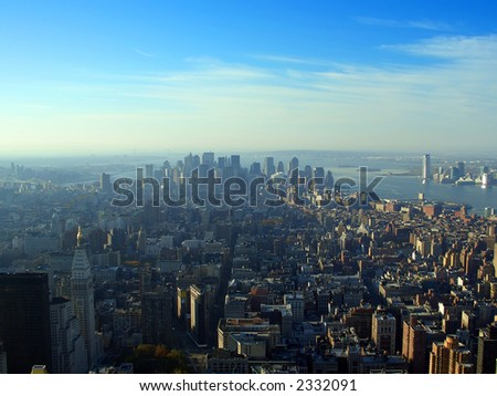 Early morning aerial view over lower Manhattan from Empire State building top, New York - stock photo