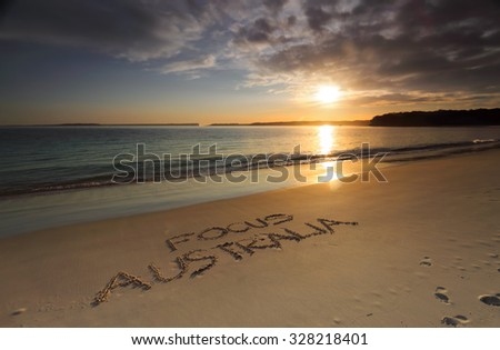 Early morning along Greenpatch Beach..  The sun shimmering on the water   Australia is the most beautiful and diverse scenic place to visit - stock photo