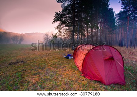 Early morning and camp - stock photo
