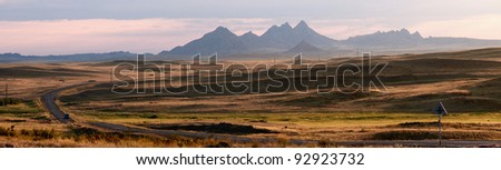 Early morning and road in desert mountains, Kazakhstan - stock photo