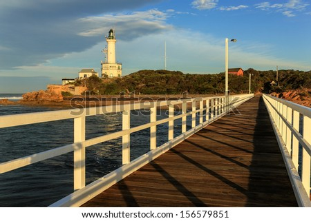 Early morning at the lighthouse and jetty at Point Lonsdale, in Victoria, Australia. - stock photo