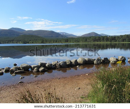 Early morning at the picturesque Loch Morlich in Glenmore, near Aviemore in the Scottish Highlands.  - stock photo